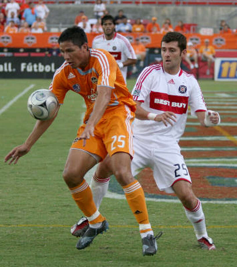 Brian Ching keeps the ball away from Chicago's Gonzalo Segares at Robertson Stadium. Photo: Thomas B. Shea, MLS Via Getty Images