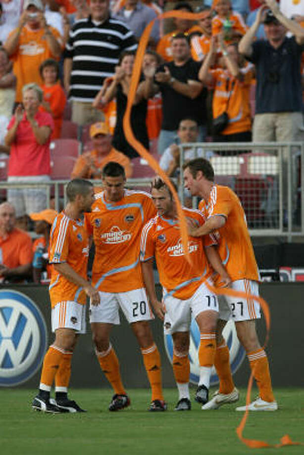 Brad Davis (second from right) celebrates with his teammates after scoring a goal in the first half of the Dynamo's MLS match against the Columbus Crew on Saturday night at Robertson Stadium. The Dynamo won 2-0. Photo: Mayra Beltran, Chronicle