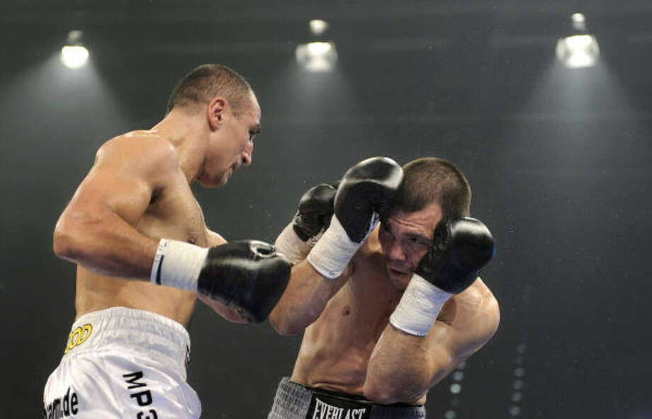 German boxer Arthur Abraham, left, punches Houston's Raul Marquez during the IBF middleweight World Championship fight in Bamberg, Germany. Photo: Christof Stache, AP