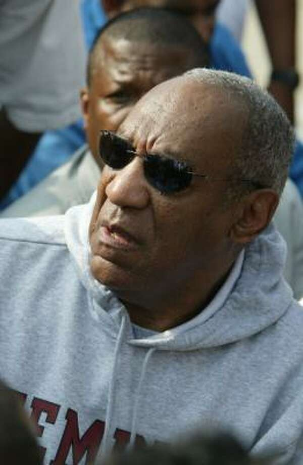 Bill Cosby talks to neighbors as he leads a march against the recent rise in homicides in Philadelphia on Monday. Photo: George Widman, AP
