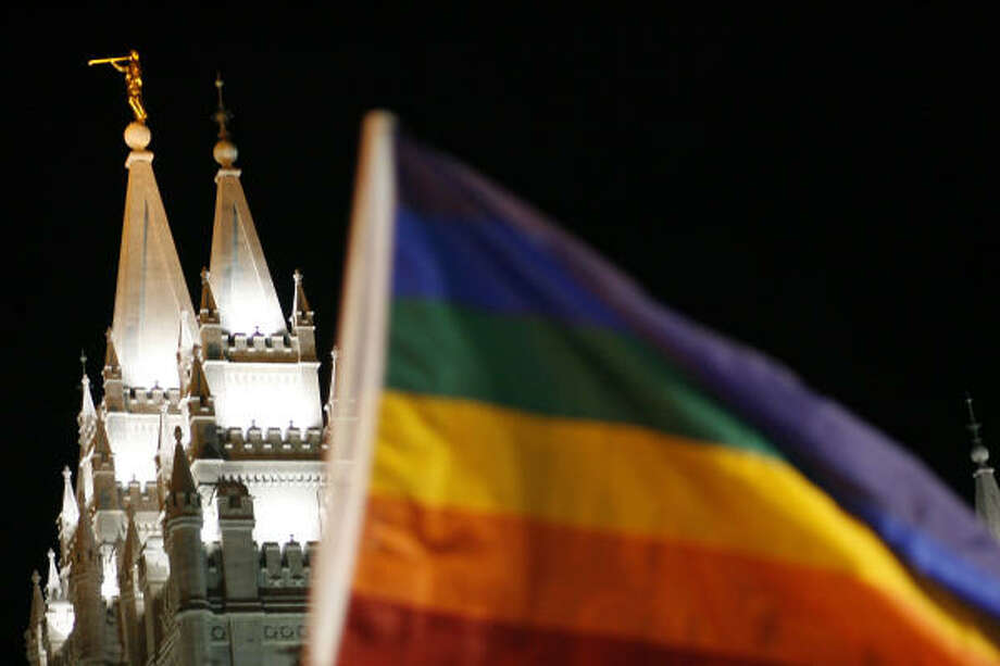 According to police an estimated 2,000 protestors gathered near the Salt Lake LDS Temple this evening, carrying signs defending gay marriage and attacking Mormon officials for the church's active campaigning on behalf of California's Proposition 8. Photo: Chris Detrick, AP
