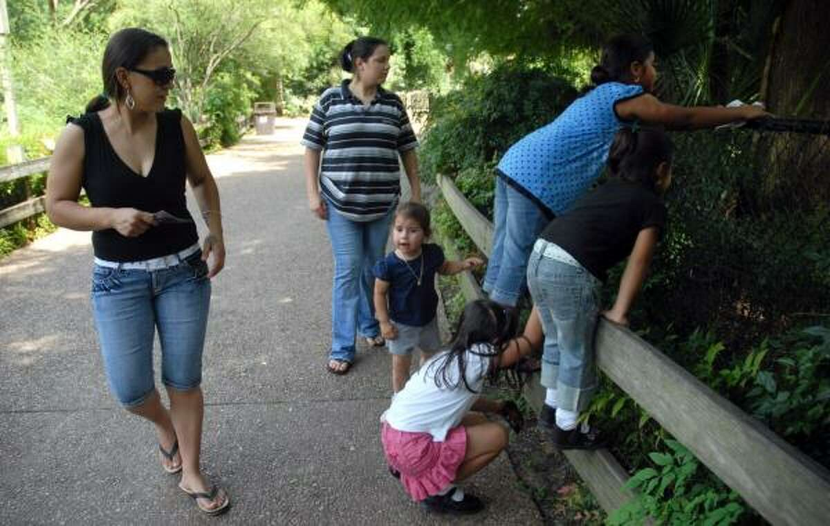 Gabriela Yanez, left, and her sister, Arcenia, and their children, spent Thursday afternoon at the Hermann Park menagerie. Yanez said she is disappointed that zoo admission will be going up to $10 for adults and $5 for children.