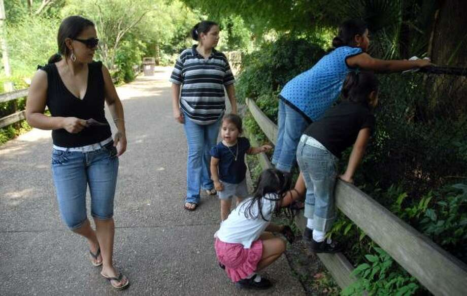 Gabriela Yanez, left, and her sister, Arcenia, and their children, spent Thursday afternoon at the Hermann Park menagerie. Yanez said she is disappointed that zoo admission will be going up to $10 for adults and $5 for children. Photo: MEGAN TRUE, CHRONICLE