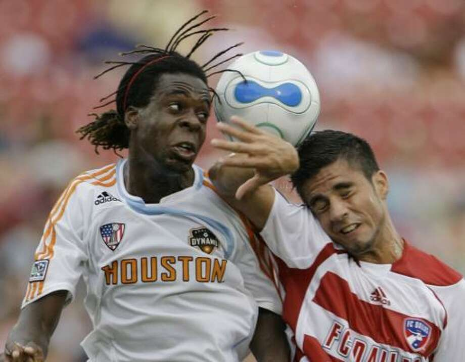 Dynamo midfielder Joseph Ngwenya, left, battles FC Dallas' Marcelo Saragosa for the ball Saturday in Frisco. Photo: MATT SLOCUM, ASSOCIATED PRESS