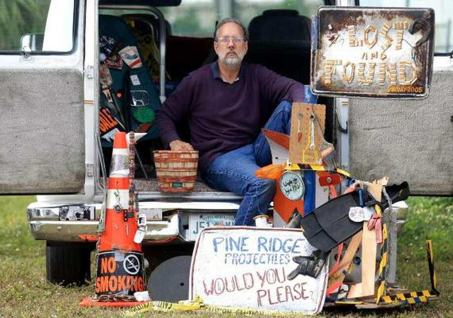 Ken Andexler creates sculptures from debris he has removed from the streets in Naples, Fla. He is starting an anti-litter campaign that uses his art to make a point about the dangers of debris. Photo: LUIS M. ALVAREZ, ASSOCIATED PRESS