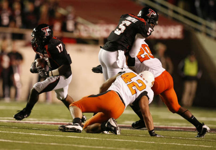 Texas Tech 56, Oklahoma State 20 Texas Tech wide receiver Detron Lewis finds running room as Texas Tech wide receiver Michael Crabtree (5) helps with a block against the Oklahoma State defense. Photo: Nick De La Torre, HOUSTON CHRONICLE