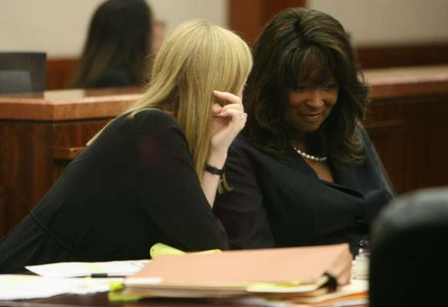 Former Texas Southern University President Priscilla Slade talks with Jennifer Carroll, one of her attorneys, during a short recess at a hearing at the Harris County Criminal courthouse. Photo: Sharon Steinmann, Chronicle