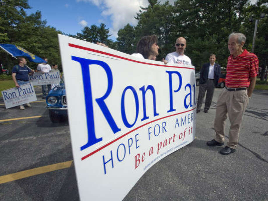 Republican presidential hopeful Rep. Ron Paul participates in the Londonderry Old Home Day Parade in Londonderry, NH, on August 18. Approximately 8,000 spectators lined up along the 1.2-mile parade route. Photo: Rick Friedman, WPN
