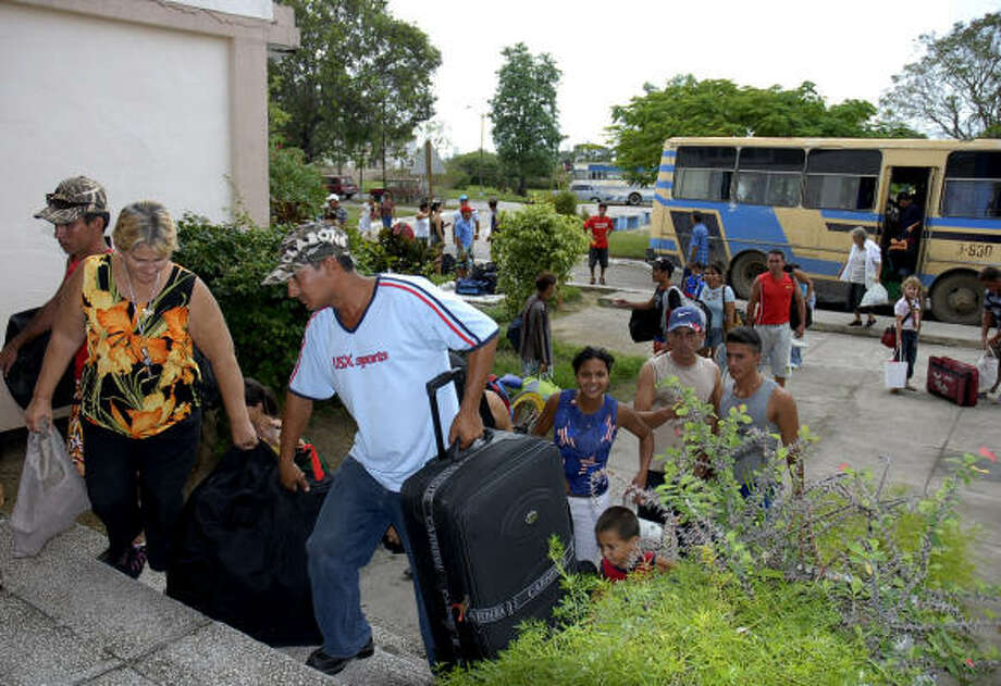 Evacuees arrive at a shelter before the arrival of Hurricane Paloma in Sancti Spiritus, Cuba, on Saturday. Former President Fidel Castro warned of new challenges for an island still reeling from two other recent storms. Photo: Manuel Brito, AP