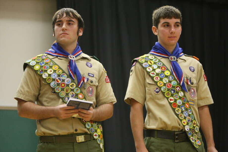 Scott Vaughan, senior at Klein Oak High, left, and brother Bryce, freshman at Klein Oak High, receive their final merit badges at LDS Klein Stake Center on 9/6/07. Photo by Thomas Nguyen/For the Chronicle. Photo: Thomas Nguyen, For The Chronicle