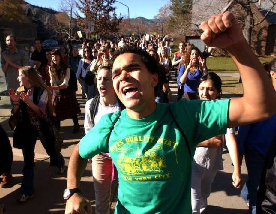 Christopher Burrell chants during a rally against racism on the University of Colorado-Boulder campus in November 2005. Several racial incidents, including a threatening e-mail sent to a student body leader, sparked the rally and class walkout. Photo: PAUL AIKEN, DAILY CAMERA FILE