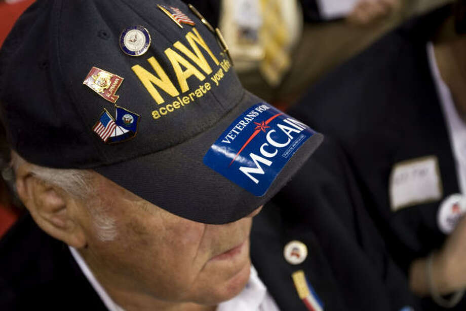 """Captain Hal Pierce, a delegate from Alabama, wears a U.S. Navy cap with a sticker reading """"Veterans for McCain"""" on day three of the Republican National Convention (RNC) at the Xcel Energy Center in St. Paul, Minnesota, U.S., on Wednesday, Sept. 3, 2008. The RNC will run until Sept. 4. Photographer: Daniel Acker/Bloomberg News Photo: DANIEL ACKER, BLOOMBERG NEWS"""