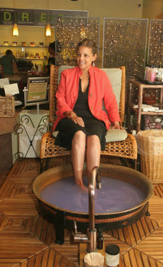 Jenice Mouton indulges in a foot soak while shopping at Naked Body and Bath at 2516 Times Blvd. Photo: Gary Fountain, For The Chronicle