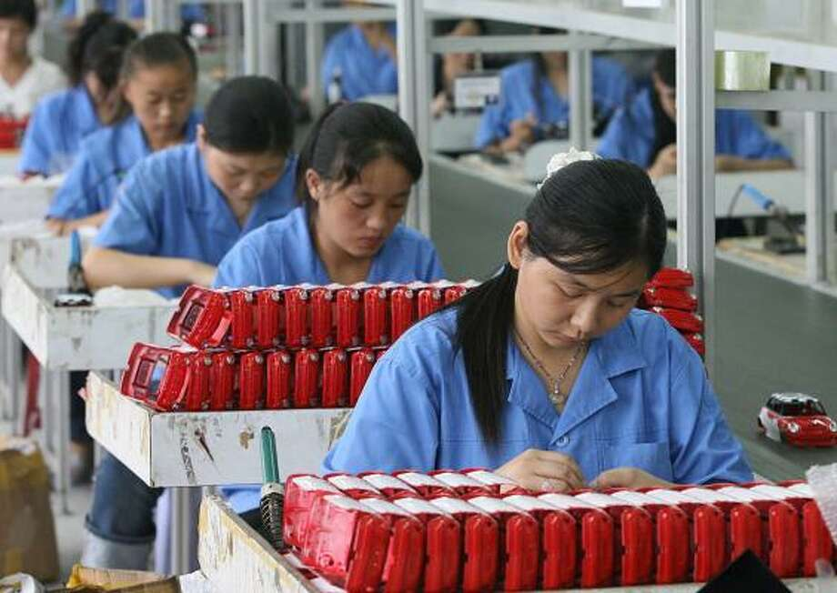 Workers assemble toys on a production line in Shantou, China. A rash of toy recalls for products made in China has led to a bill that would ban the import of items made in sweatshop conditions. Photo: AFP/GETTY IMAGES