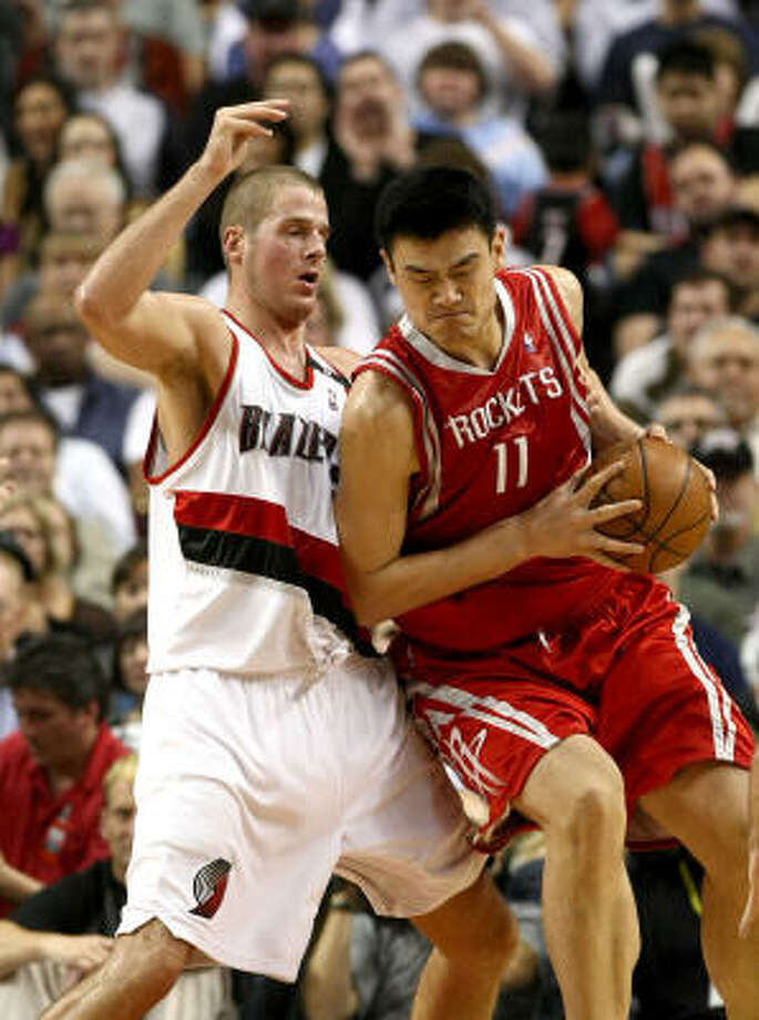 Rockets center Yao Ming (11) had a tough time against Joel Przybilla in Thursday night's game against the Portland Trail Blazers. Yao was held to 13 points on 4-of-13 shooting in the Rockets 101-99 loss. Photo: Jonathan Ferrey, Getty Images