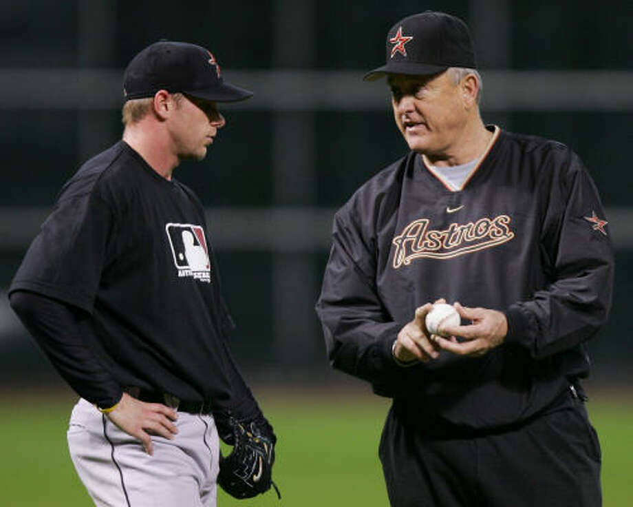 Despite ending up in the hospital Friday, Nolan Ryan, right, expects to participate in his elite camp for top pitching prospects in the Astros organization, which begins Monday. Last season, he worked with young pitchers, including Brandon Backe, at Minute Maid Park. Photo: DAVID J. PHILLIP, AP