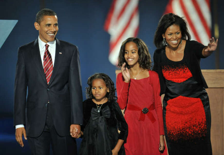 Michelle Obama, right, wore a Narciso Rodriguez black and red dress on election night. Photo: STAN HONDA, AFP/Getty Images
