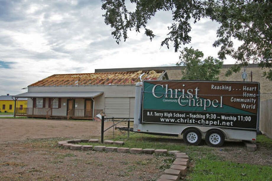 The metal corrrogated roof atop the Christ Chapel at the corner of  FM 1640 and Avenue I in Rosenberg was blown off into the alley behind the church by Hurricane Ike. Photo: Suzanne Rehak, For The Chronicle