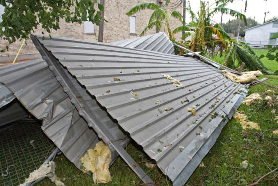 The metal corrogated roof of the Christ Church at the corner of FM 1640 and Avenue I in Rosenberg was blown off by Hurricane Ike. Photo: Suzanne Rehak, For The Chronicle