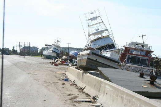 Boats near Galveston Daily News on highway Photo: Gene Haddock, Chronicle Vice President, Circulation