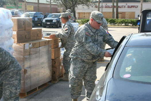 National Guard helps distribute copies of the Houston Chronicle Photo: Gene Haddock, Chronicle Vice President, Circulation