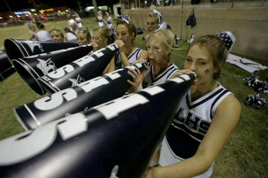 The Concordia Lutheran cheerleaders cheer on the Crusaders against Westbury Christian. Photo: Matthew White, For The Chronicle