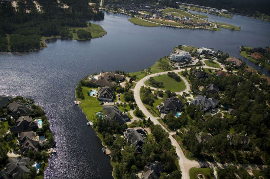 Homes and water are seen in The Woodlands.