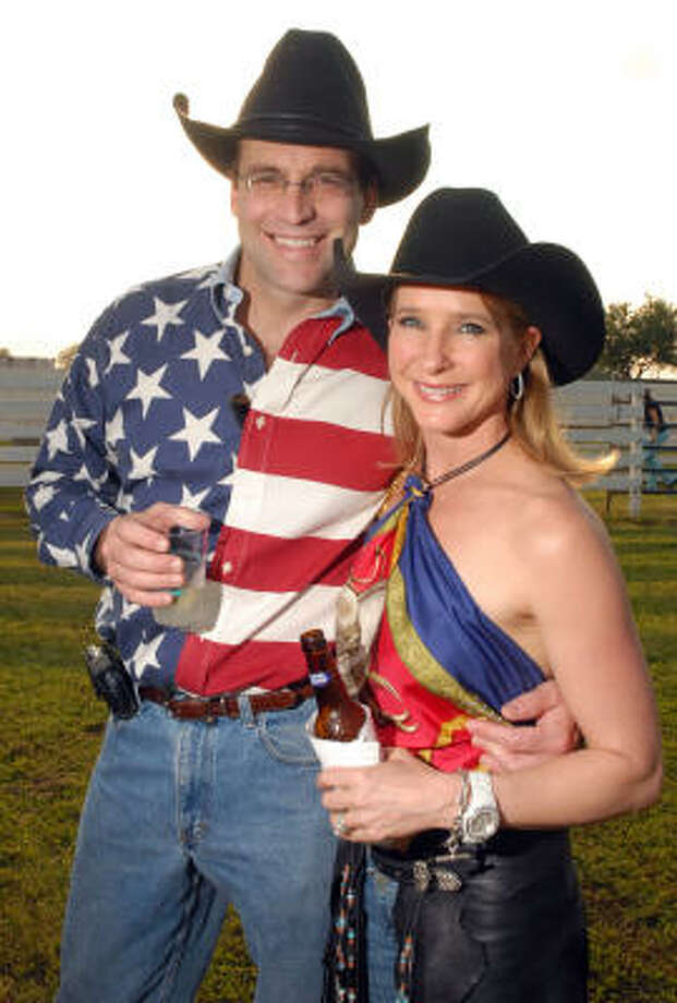 Ker and Rachel Thomson chose red, white and blue for their Cattle Baron's attire. Photo: Dave Rossman, For The Chronicle