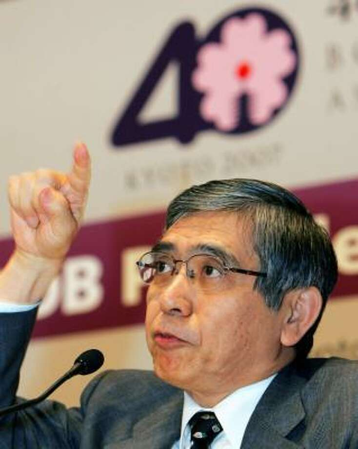 Haruhiko Kuroda, president of the Asian Development Bank, handles a question Monday in Kyoto, Japan. A bank conference ended with some saying the fight against poverty is far from won despite the continent's increasing wealth. Photo: KATSUMI KASAHARA, ASSOCIATED PRESS