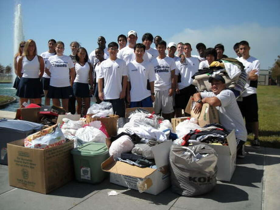 DOING THEIR PART:LSC-Cy-Fair's Tennis Team, Catholic Student Union and X-Presate members recently collected a lot of household items and clothes to help several families in Galveston recovering from Hurricane Ike. Above, the Tennis Team's donations were among three truckloads of contributions collected in just two weeks. Photo: Submitted Photo