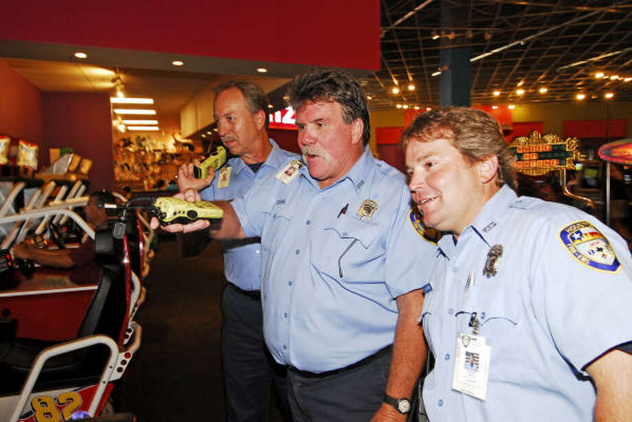 Firefighters Mike Woodard, Rick Nowak and Donnie McComb from the Houston Fire Department Station 96 toured IT'Z. Photo: Tony Bullard, For The Chronicle