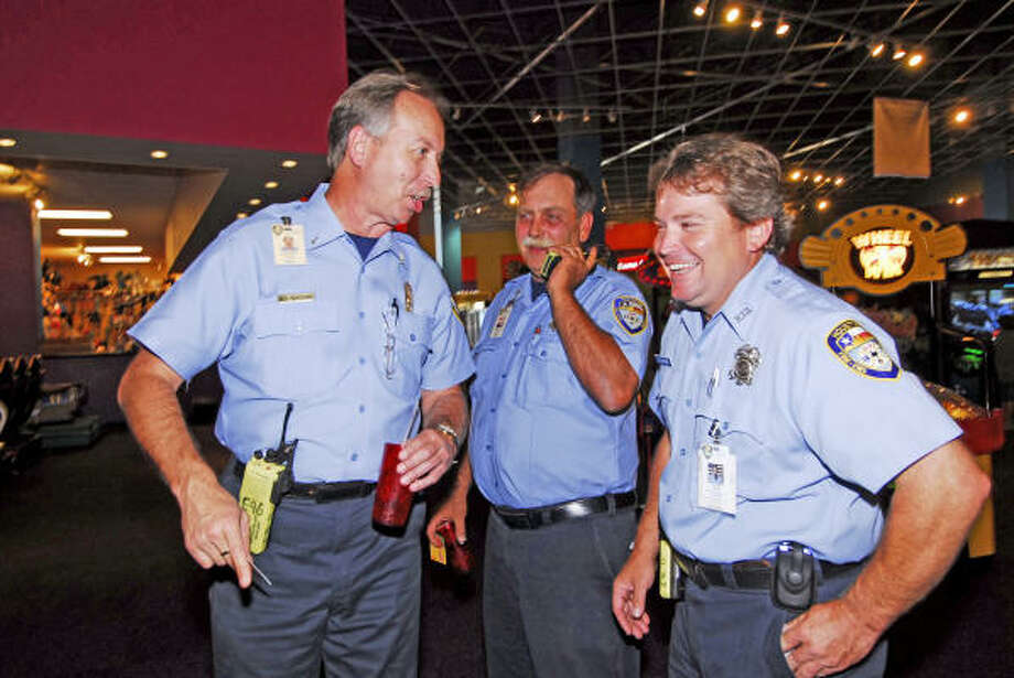 Firefighters Mike Woodard, Chris Michels and Donnie McComb from the Houston Fire Department Station 96 toured IT'Z. Photo: Tony Bullard, For The Chronicle