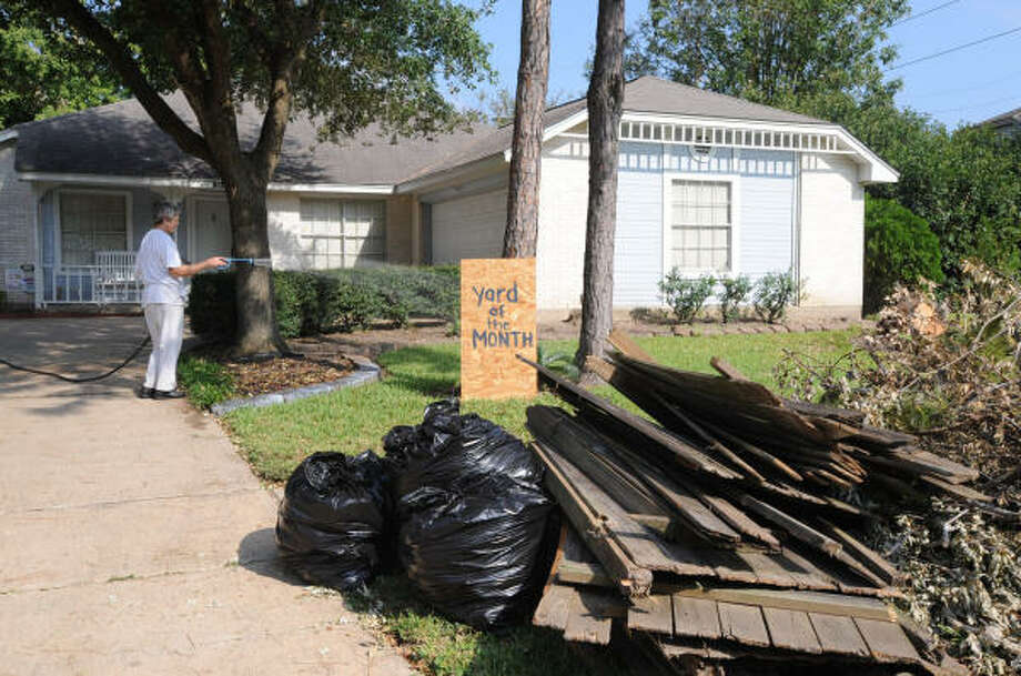 Copperfield's Northmead Village resident Margaret Shanks tries to beautify her front yard Sept. 22 after Hurricane Ike left a mess. Photo: Thomas Nguyen, For The Chronicle