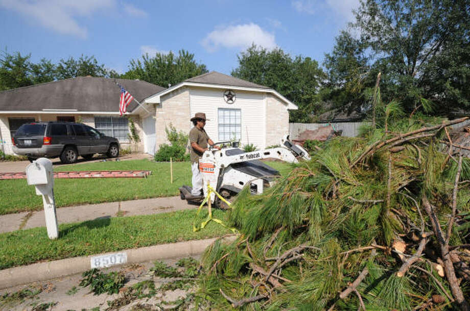 Maryland based Arborcare Tree Expert, contracted by Nationwide Insurance, works on Tony Moghaddam's damaged yard in Northmead Village on Sept. 20. Photo: Thomas Nguyen, For The Chronicle