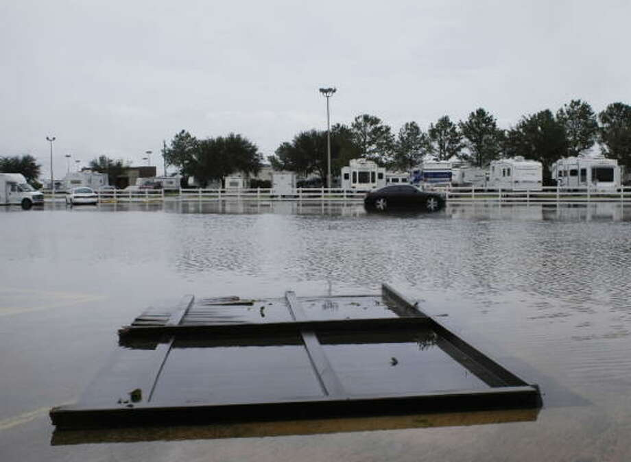 A section of cedar fence floats like a small raft in the flooded parking lot at Traders Village during Hurricane Ike. Photo: TradersVillage, Chron.commons Member