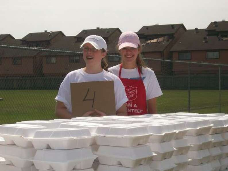 Erin Peterson and Abbey King are ready to hand out meals at the Salvation Army.