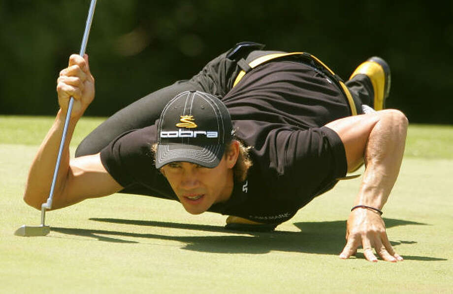 Camilo Villegas, who is two strokes out of the lead, lines up a putt on the eighth green during the third round of the AT&T Classic at TPC Sugarloaf  in Duluth, Georgia. Photo: Scott Halleran, Getty Images