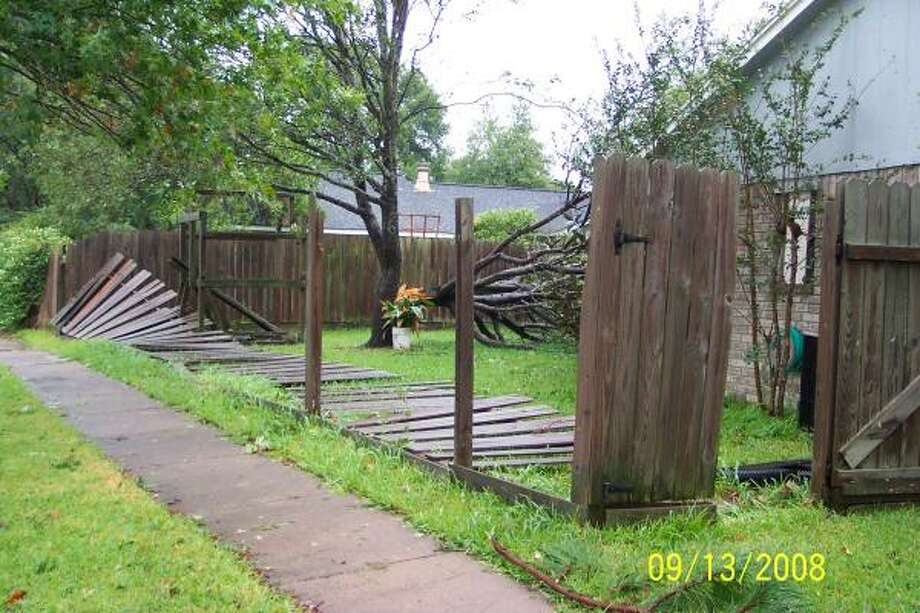 Split tree and downed fencing in Cypress Photo: Marynet, Chron.commons Member