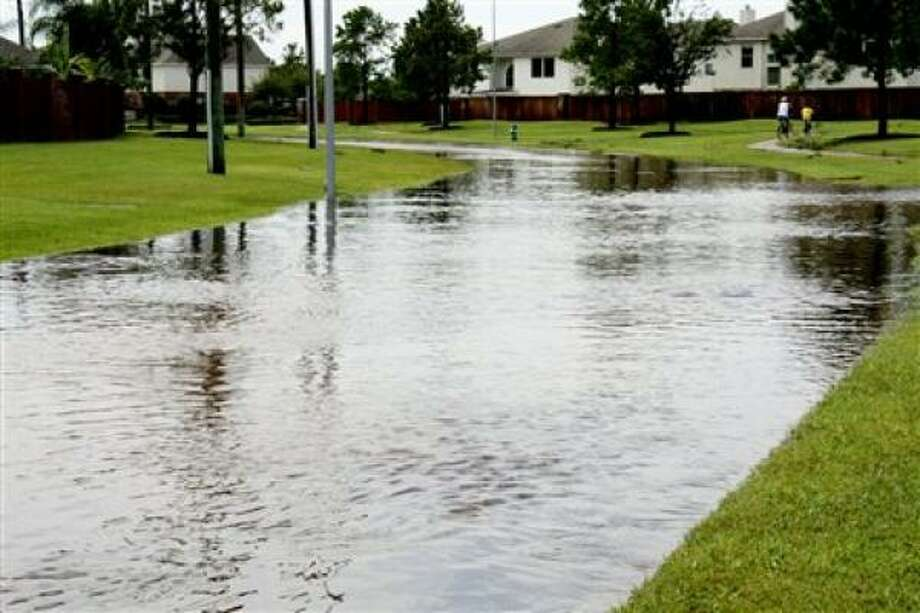 Street flooding in Canyon Lakes in Cypress Photo: Teamjtx, Chron.commons