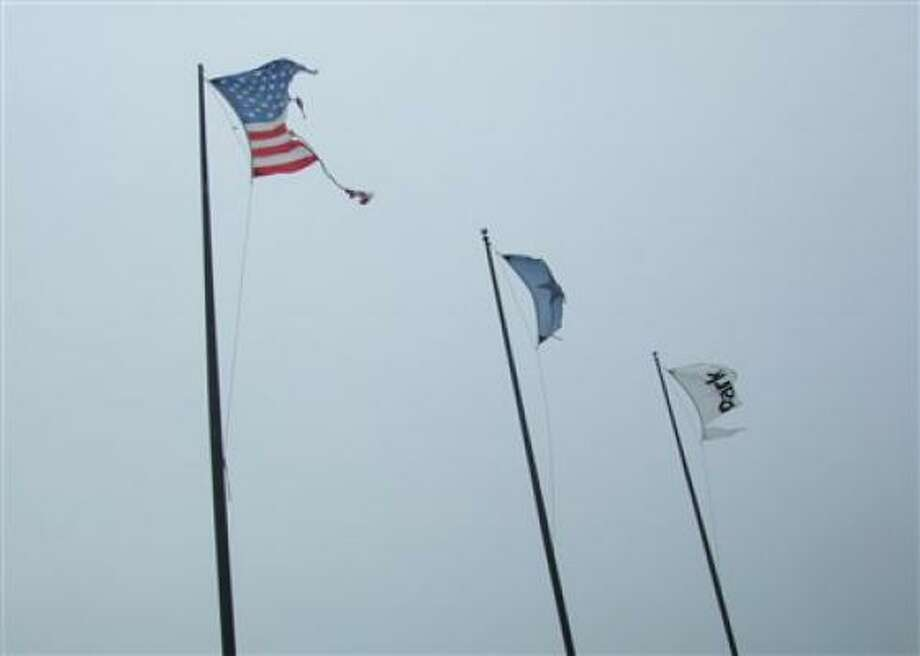 Remnants of flags wave at Barker Cypress and Park Row. Photo: Injuneartallgrass, Chron.commons