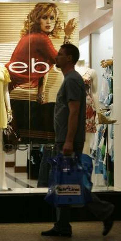 A shopper passes a window display in a Denver mall. Concerns about inflation because of rising gasoline prices could not stop consumer confidence from rebounding in May. Photo: DAVID ZALUBOWSKI, ASSOCIATED PRESS