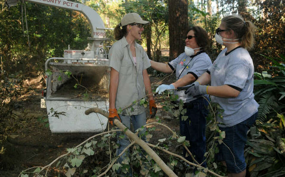 PICKING UP THE PIECES: Delores Stevens, left, a member of the horticulture staff at Mercer Ar