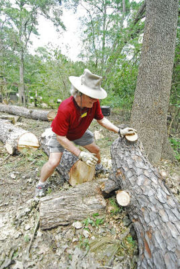 Volunteer Bill Taylor helps clear fallen trees at the Houston Arboretum & Nature Center. Photo: Tony Bullard, For The Chronicle
