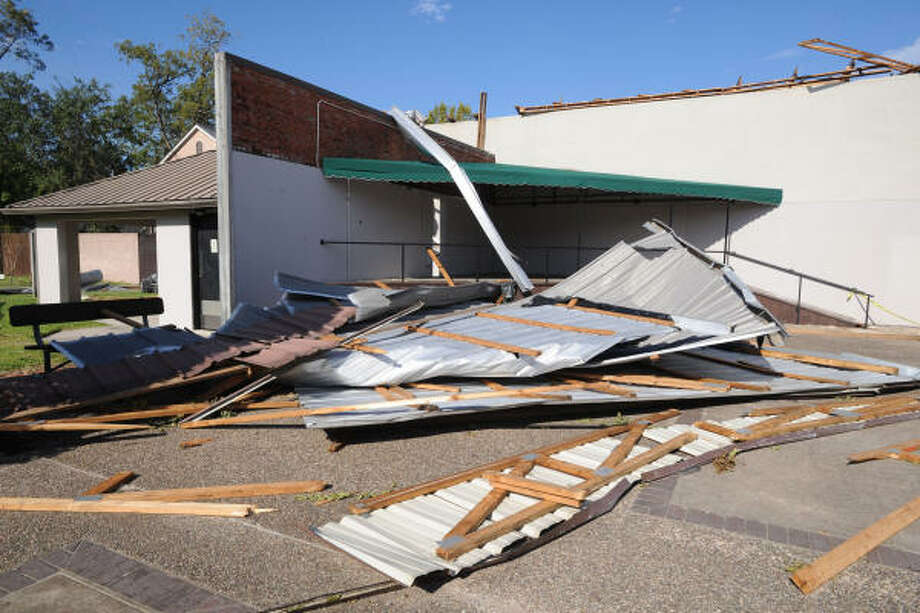 The K.Austin & Associates building at 302 E. Main in Humble suffered extensive roof damage that spilled over to the City of Humble Uptown Park after Hurricane Ike passed through the Humble/Kingwood area. Photo: Thomas Nguyen, For The Chronicle