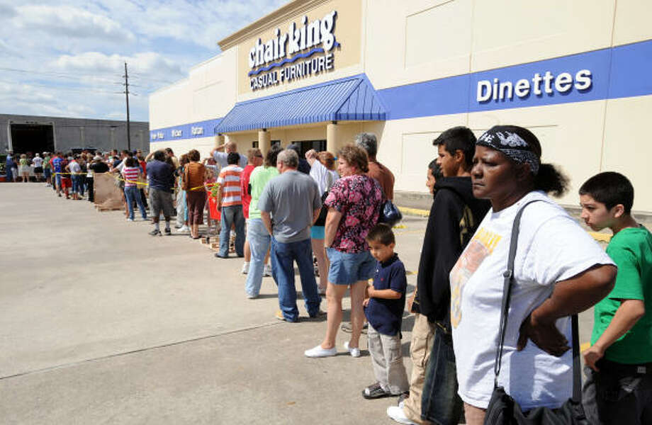 People stand in line to purchase power generators from Silver Dollar Sales in Belmont, Mississippi at a Chair King parking lot at Eastex Freeway, near FM 1960. Photo: Thomas Nguyen, For The Chronicle