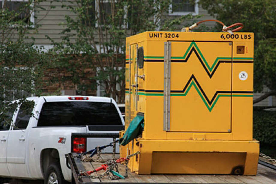 A generator powers a house in a Humble/Kingwood neighborhood. Photo: Twilightimagingnet, Chron.commons Member