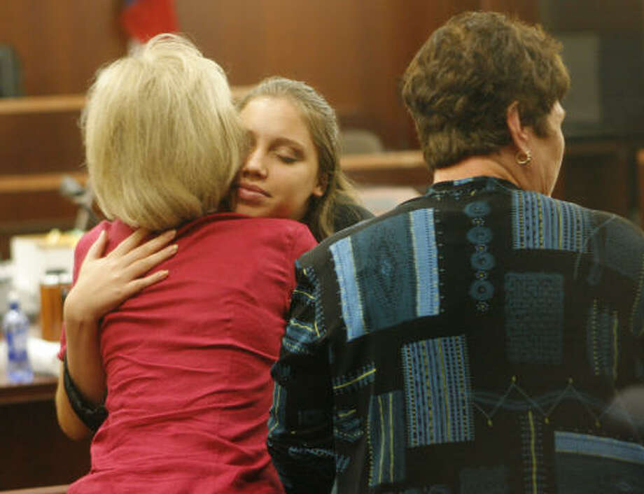 Ashley Benton, center, is comforted by supporters during a break in her murder trial. Photo: Steve Campbell, Chronicle