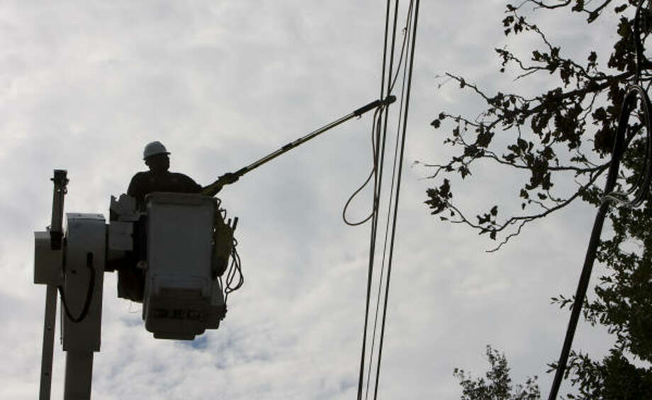 Richard Johnson, head lineman for CenterPoint Energy works on a power line at McAulty and Aldine-Westfield on Wednesday. Photo: Steve Campbell, Chronicle