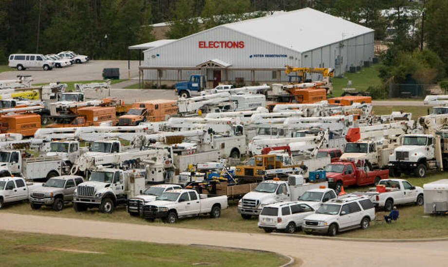 Electric and tree trimming companies from across the country gathered in Conroe's Montgomery County Fairgrounds awaiting repair assignments from Entergy on Monday. Photo: Steve Campbell, Chronicle