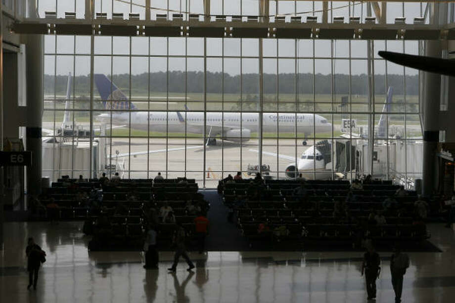 Bush Intercontinental Airport was reopened Monday. A Continental plane taxies past Terminal E. Residents in the areas north of Houston continue to recover from Hurricane Ike. Photo: Steve Campbell, Chronicle